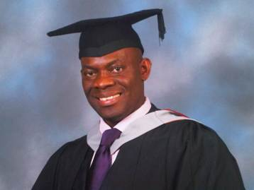 Photo of Brian Kokoruwe taken at his degree graduation ceremony